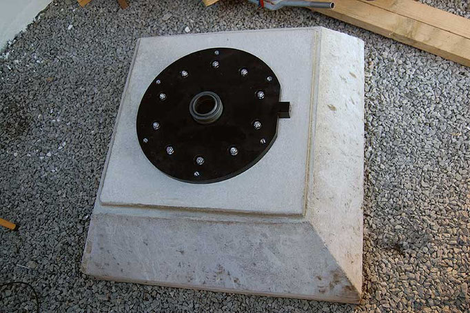 The baseplate is bolted to the concrete footing.