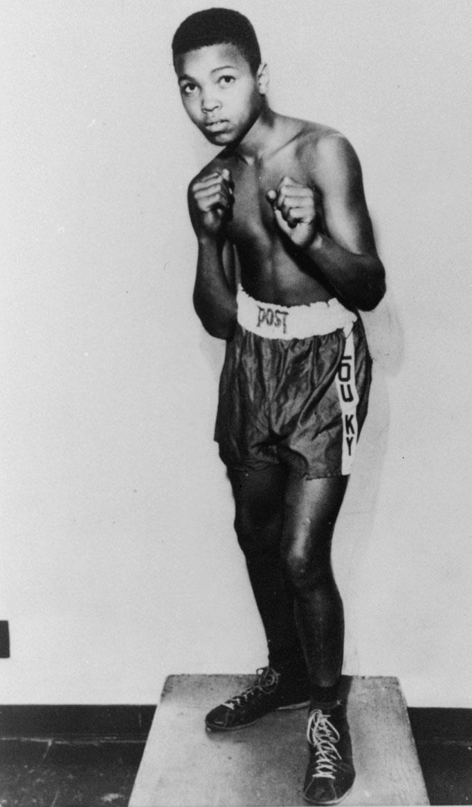 Eighty-five pound Cassius Marcellus Clay, Jr., is shown posing at twelve, prior to his amateur ring debut in 1954, a three minute, three round split decision over another novice named Ronnie O'Keefe, in Louisville, Kentucky (Bettman/Getty)