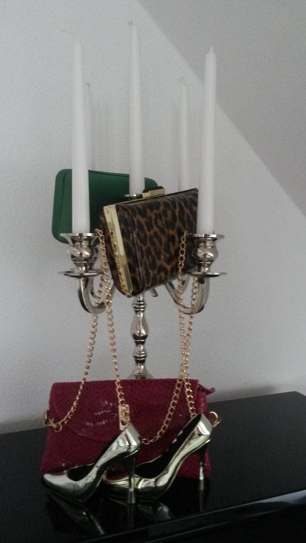 Kandelaber mit Handtaschen