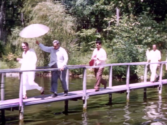 1956 ; Meher Center, Myrtle Beach, SC. ; Meher Baba walking across the Center's bridge. The images were captured by Anthony Zois from a film by Sufism Reoriented.