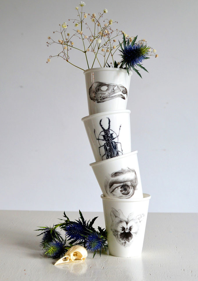 'Porcelain cups' a series of porcelain cups with a ceramic transfer