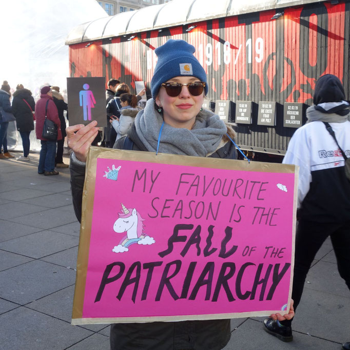 Visitor with CO-WC sign at International Women's Day in Berlin, 2019.