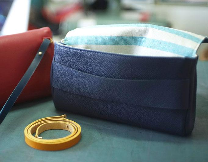 Pochette de soirée en cuir label fabriqué à Paris. Leather bag made in Paris.