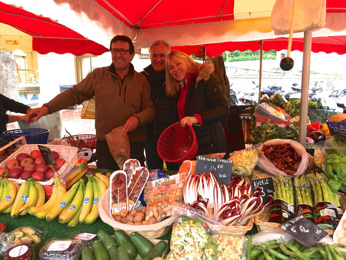 Romano, Zsolt and Eva in their fruits and vegetables stand