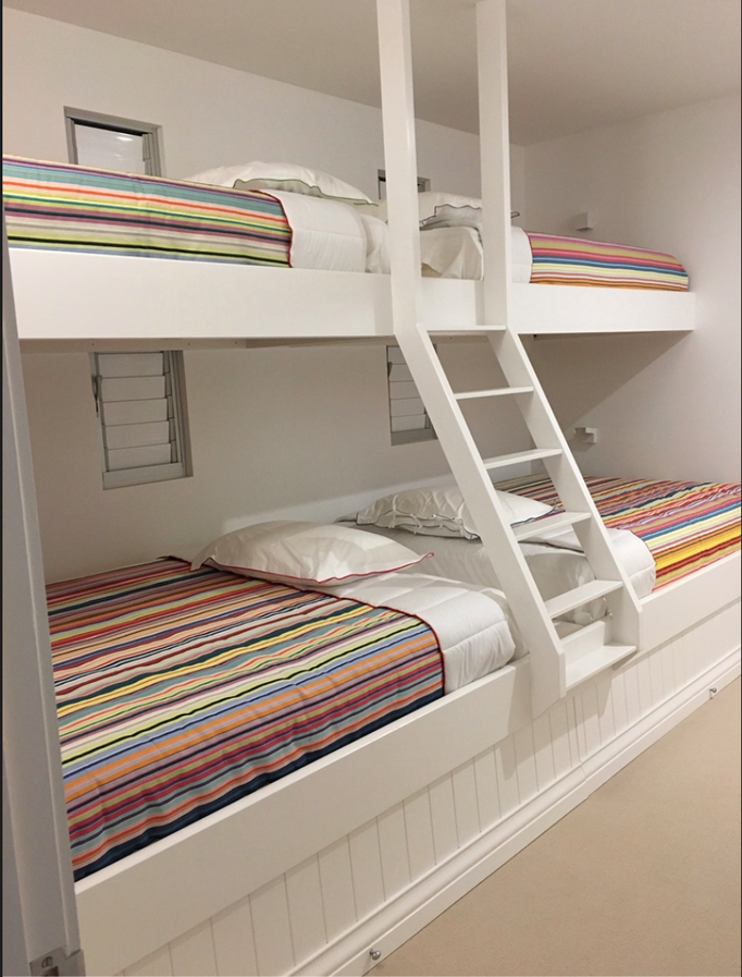 Bed bunks with Les Toiles du Soleil striped cotton canvas bed cover