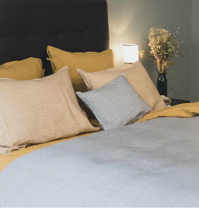 Grey/blue Caravan linen duvet with pillows and bed lamps