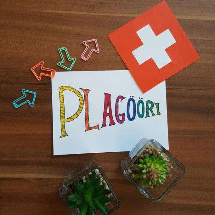 Handlettering auf Schweizerdeutsch: Plagööri (Angeber, Grossmaul)