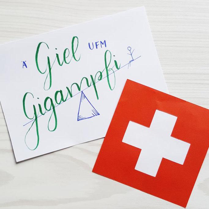 Ä Giel ufm Gigampfi - schweizerdeutsches Handlettering (Ein Junge auf der Wippe)