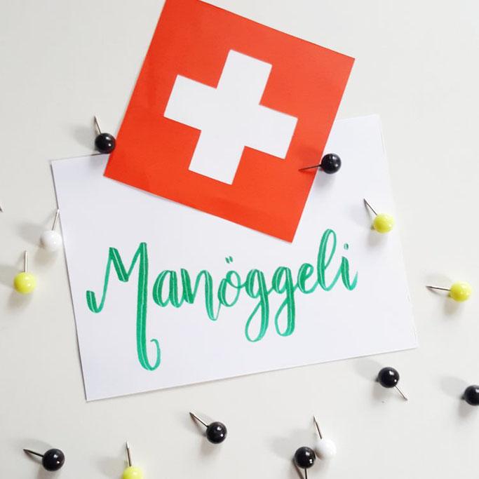 Schweizerdeutsches Handlettering: Manöggeli (Spielfigur)