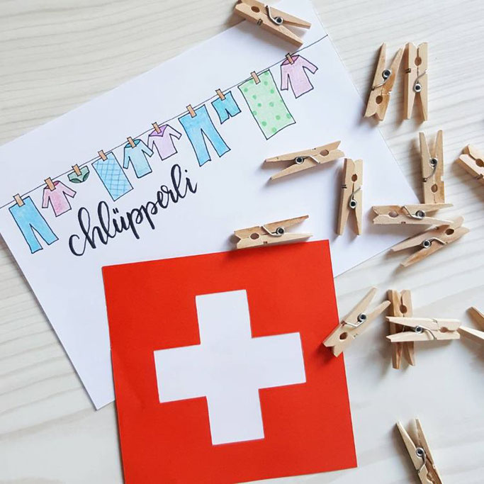 Lettering auf Schweizerdeutsch: Chlüpperli (Wäscheklammer)