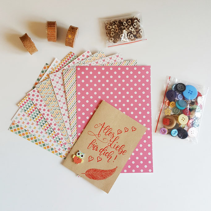 Letter Lovers Gewinnspiel: Preis 3 - ein Kreativpaket mit Washitape, speziellem Papier, Holzherzen und Knöpfen