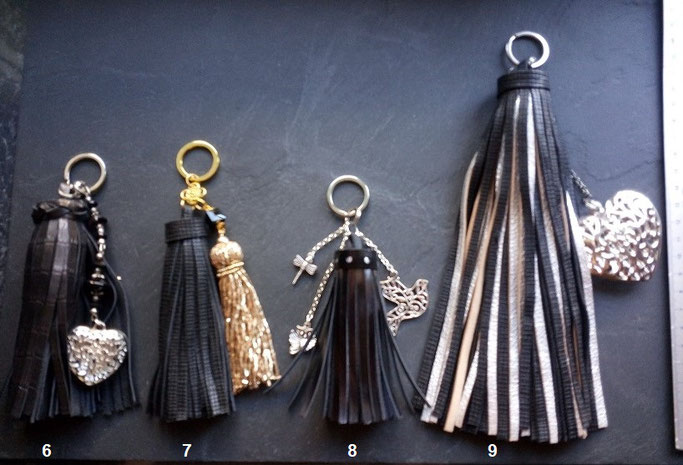 Pompons noirs avec charms pompons perles, coeur, oiseau, ... n°6-7-8 : 10.00 €, pompon n°9 : 15.00 €