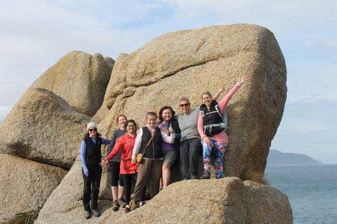 A group of happy ladies climbed a rock at Wilsons Prom National Park, Gippsland, Australia