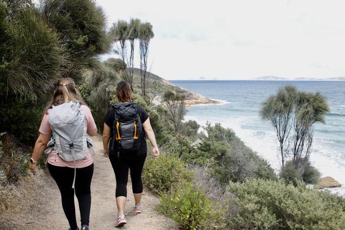 Two ladies hiking past ocean views at Wilsons Prom National Park