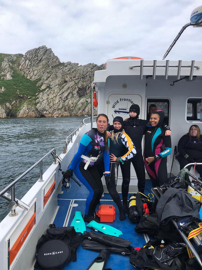 Girls that Scuba wrapping up for a cold but FUN day at Lundy Island
