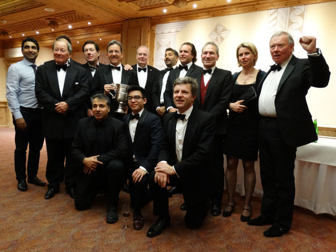 Old Cholmeleians XI posing at the gala dinner with the HM Ambassador David Moran in 2017