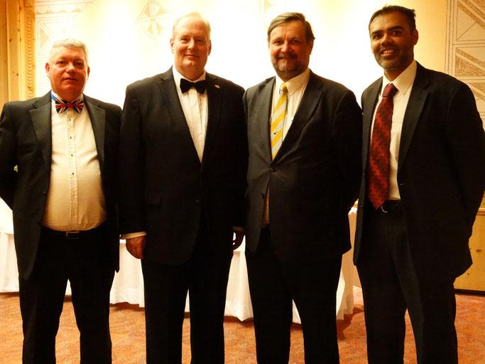 The umpires with the HM Ambassador, Mr. David Moran (second left)