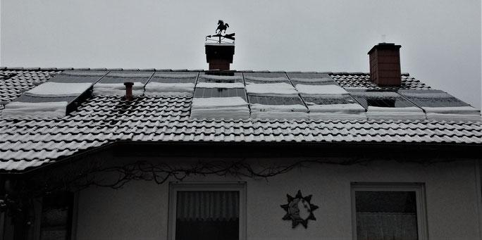 Lewben mit der Energiewende TV - rutschender Schnee auf Photovoltaikanlage in Rehborn am Glan