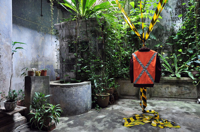 Code Maroon - Baboon House, Melaka 2012: Anthony Pelchen – installation (found suit, adjusted Hi-Vis vests, barrier tape) & sampled sound (sheep) / Kavisha Mazzella – voice and harmonium / Frank van de Ven – performance / Robbie Millar – mixing / L Esmore