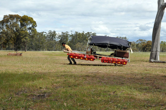 Roger Soong hauls raft to Wimmera River, Oct 28, 2013