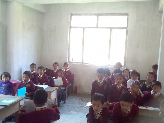 Children learning in the new bright classroom. March 2013