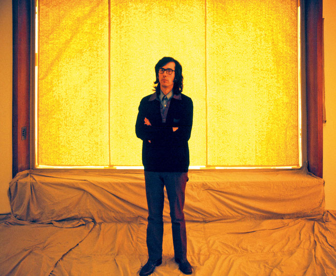 Wolgang Volz's first photograph of artist Christo, taken during Christo's and Jeanne-Claude's installation Wrapped Floors and Stairways and Covered Windows at Museum Haus Lange, Krefeld, Germany, in 1971.