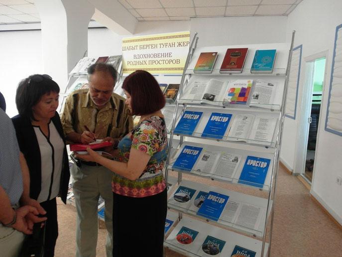 областная библиотека, Сабит Муканов, Куандык Туменбай