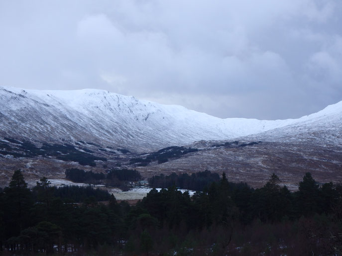 Grey sky over snowy mountains, Rannoch Moor, West Highland Way in Winter