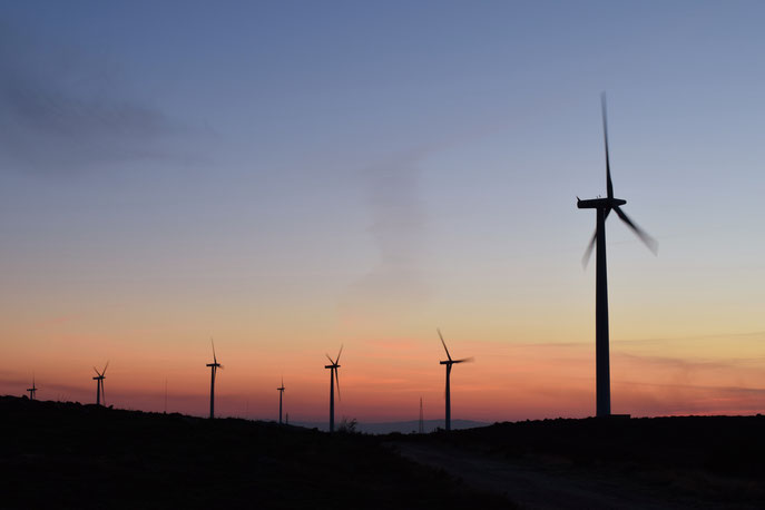 wind turbines Portugal why travel sunset