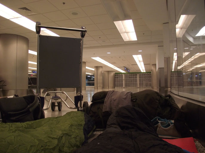 I think we've refined the airport bed quite well. Screw trying to sleep on the metal chairs- make a bed on the floor!