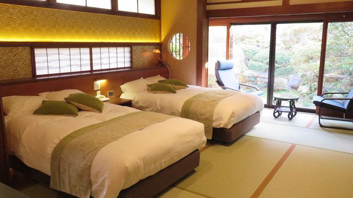 和室を改造して、ご年配、外国人、障害のあるお客様でも安心してご利用できるようにセミダブルベッド化しました。(和モダンタイプ