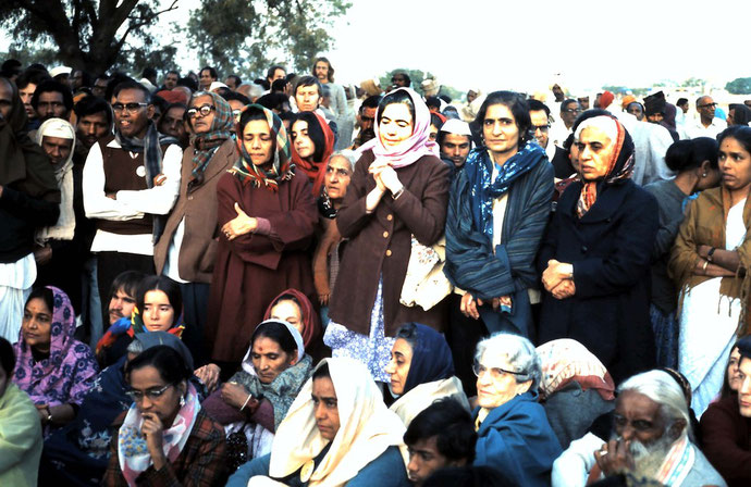 Photo taken by Anthony Zois ; Dhuni at Meherabad, January 1975 - Rano is seated front-centre right wearing glasses
