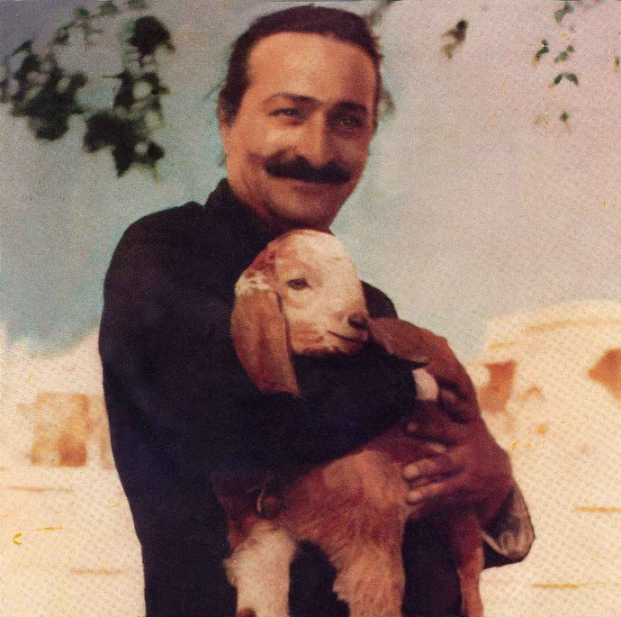 Meher Baba with kid goat in Alwar village 1940: Glow cover photo - May 1994