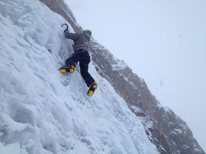 """One of my client on the ice cliff of """"Symphonie d'Automne"""" in a beautiful """"winter"""" day."""