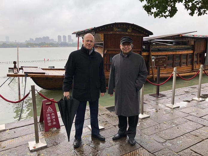 "Pictured in front of ""Red Boat"" in South Lake, Jiaxing, Zhejiang Province"