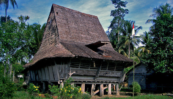 "BU211F302_""House in Nias North Sumatra"" by monica renata from jakarta - central nias. Licensed under CC BY 2.0 via Commons - https://commons.wikimedia.org/wiki/File:House_in_Nias_North_Sumatra.jpg#/media/File:House_in_Nias_North_Sumatra.jpg"