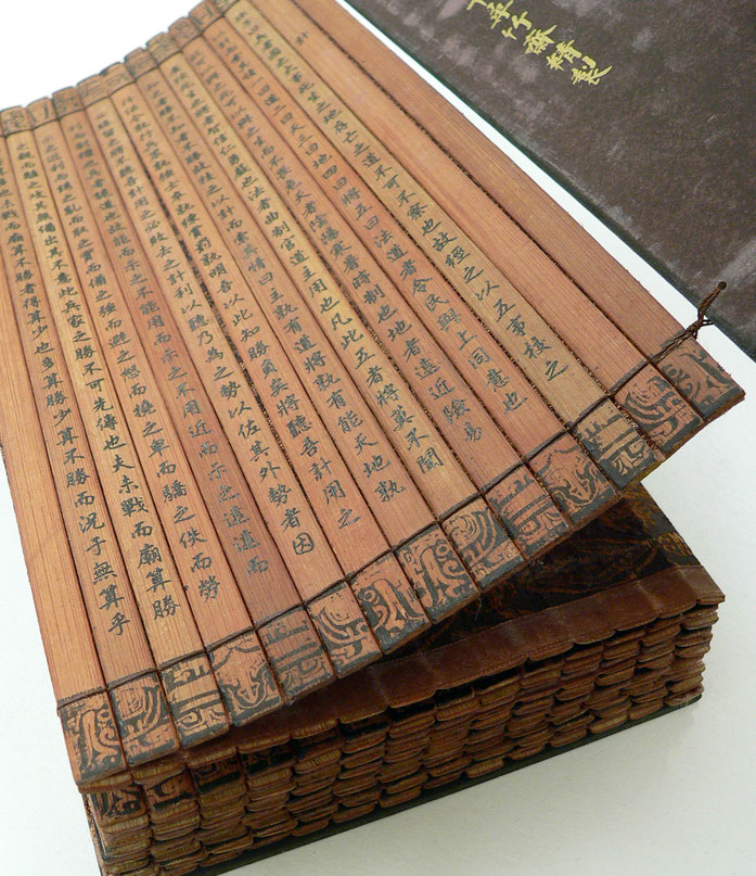 """Bamboo book - binding - UCR"" by vlasta2, bluefootedbooby on flickr.com - http://flickr.com/photos/bluefootedbooby/370458424/. Licensed under CC BY 2.0 via Wikimedia Commons - https://commons.wikimedia.org/wiki/File:Bamboo_book_-_binding_-_UCR.jpg#/media/"