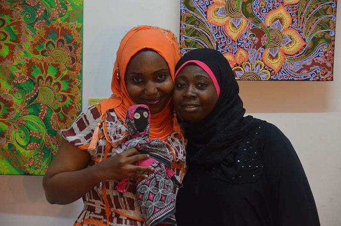 Jamila Mataka (left) with Najma Ameir Khamis from the Hurumzi Henna Art Gallery