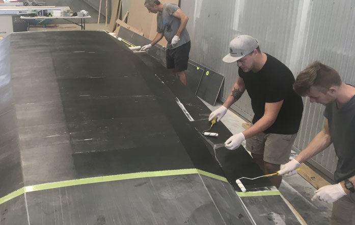 Hand laminating the external laminate R42 trimaran