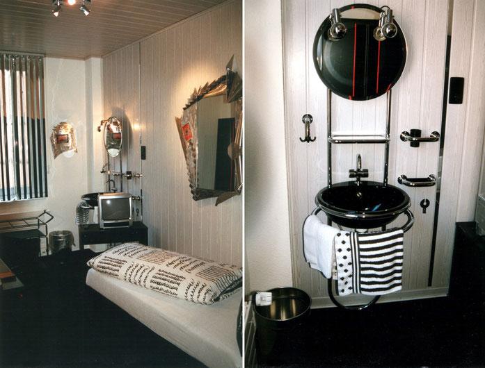 Foto: Einzelzimmer mit Designer-Waschbecken und handgefertigtem Spiegel
