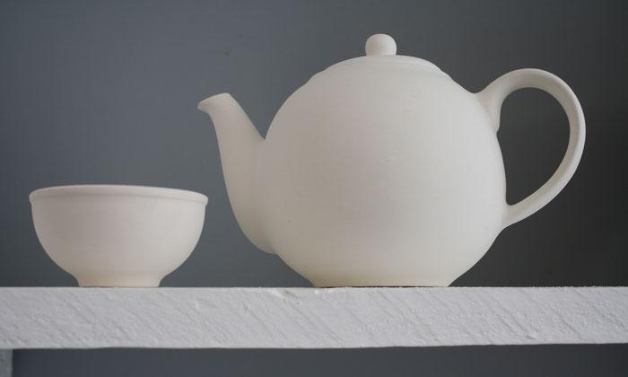 Keramiktasse und Keramikkanne