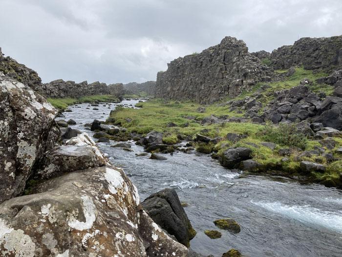 The Oxara River flowing through the mighty Almannagja Rift.