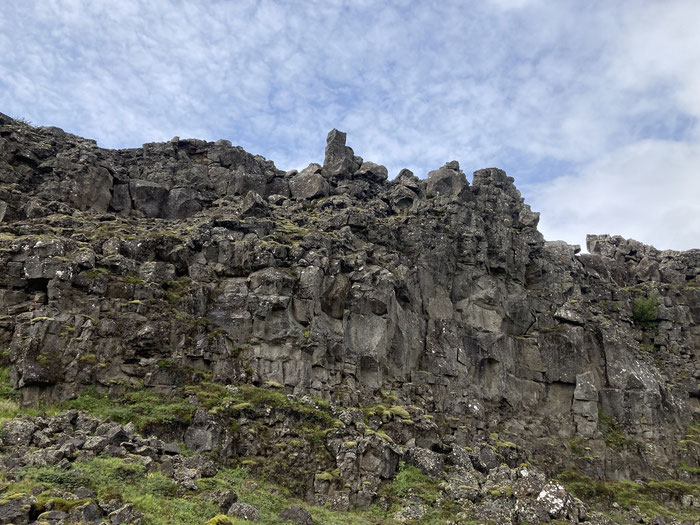 The towering presence of Almannagja. It forms one side of a rift valley within the Mid-Atlantic Ridge between North America and Eurasia. This was the spectacular back drop of the Althing Assembly.