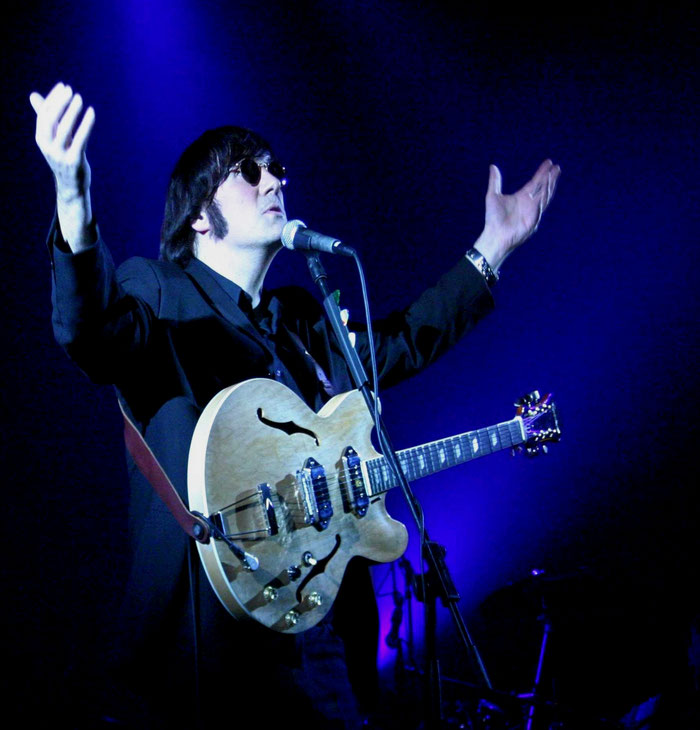 Johnny Silver as John Lennon blue