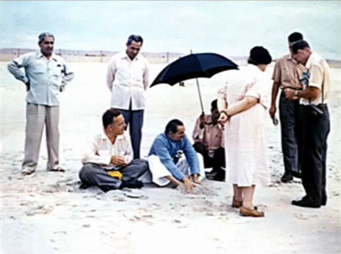 1956 ; Meherjee is standing behind Baba at the Center's beach, Myrtle Beach, SC.