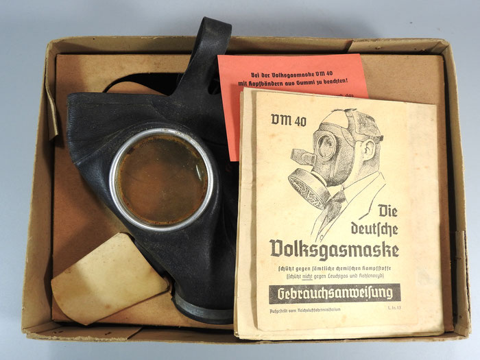 WW2 - GERMAN GAS MASK. ALL ORIGINAL, NEW OLD STOCK IN BOX. This is reference for how Frowo made lanterns from Gas Masks after the war