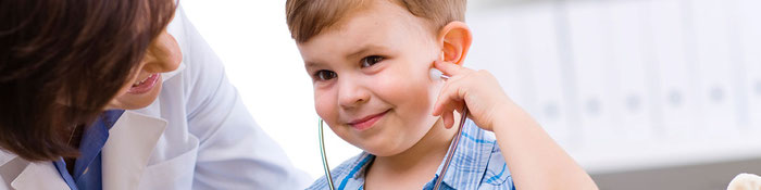 Little boy with stethoscope female doctor