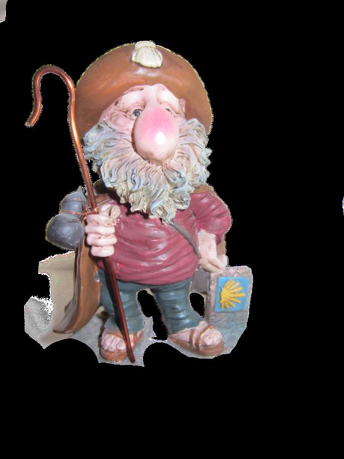 Eine Pilgerfigur mit Wanderstab und Kalebasse