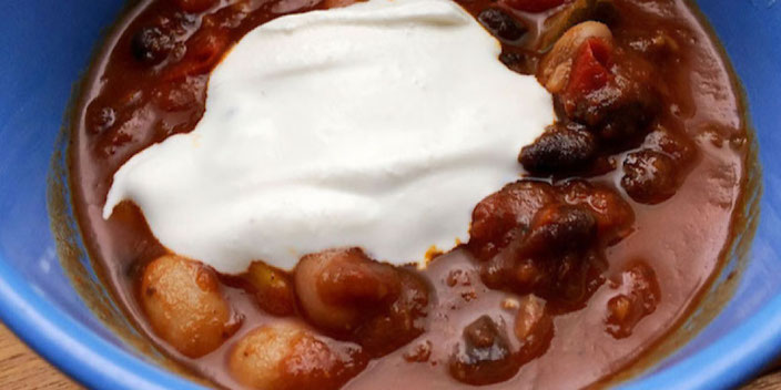 vegan chili with sour cream laughing planet cafe