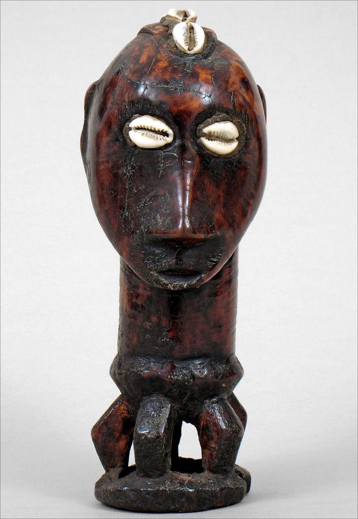 Iginga figurine, Lega, Pangi, Kivu, DRC • Ivory, cowries shells • Collected by D. Biebuyck in 1952 • Royal Museum for Central Africa, Tervuren • Accession # RG 55.3.145 • H. 19 cm